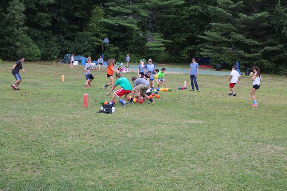 campers meet at the centerline at the start of a dodgeball game
