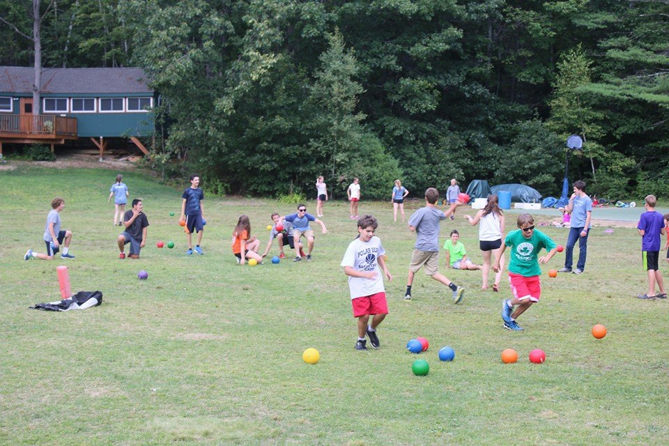 campers playing doctor dodgeball in the field