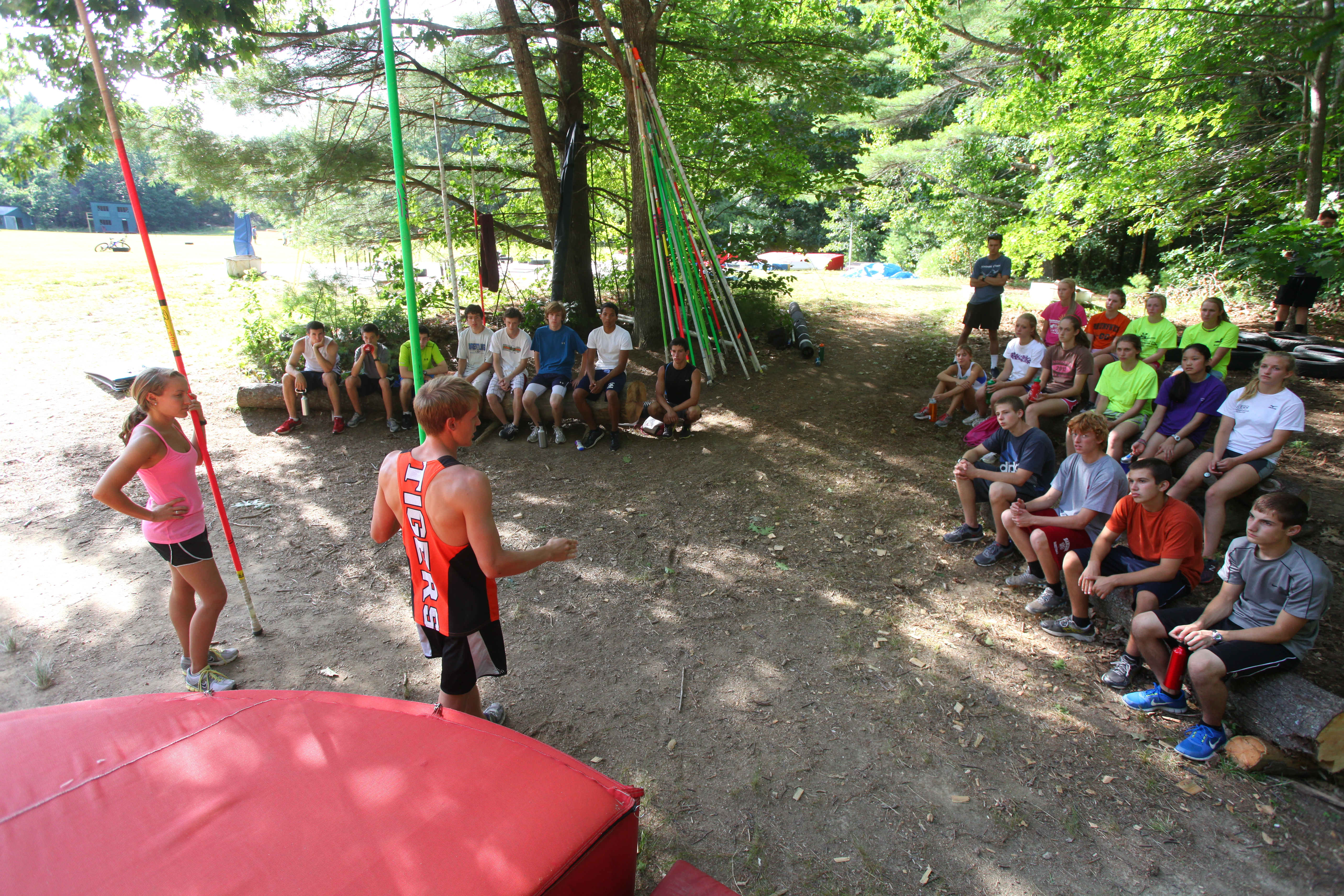 Campers receiving instruction at the field pit from Tarzan
