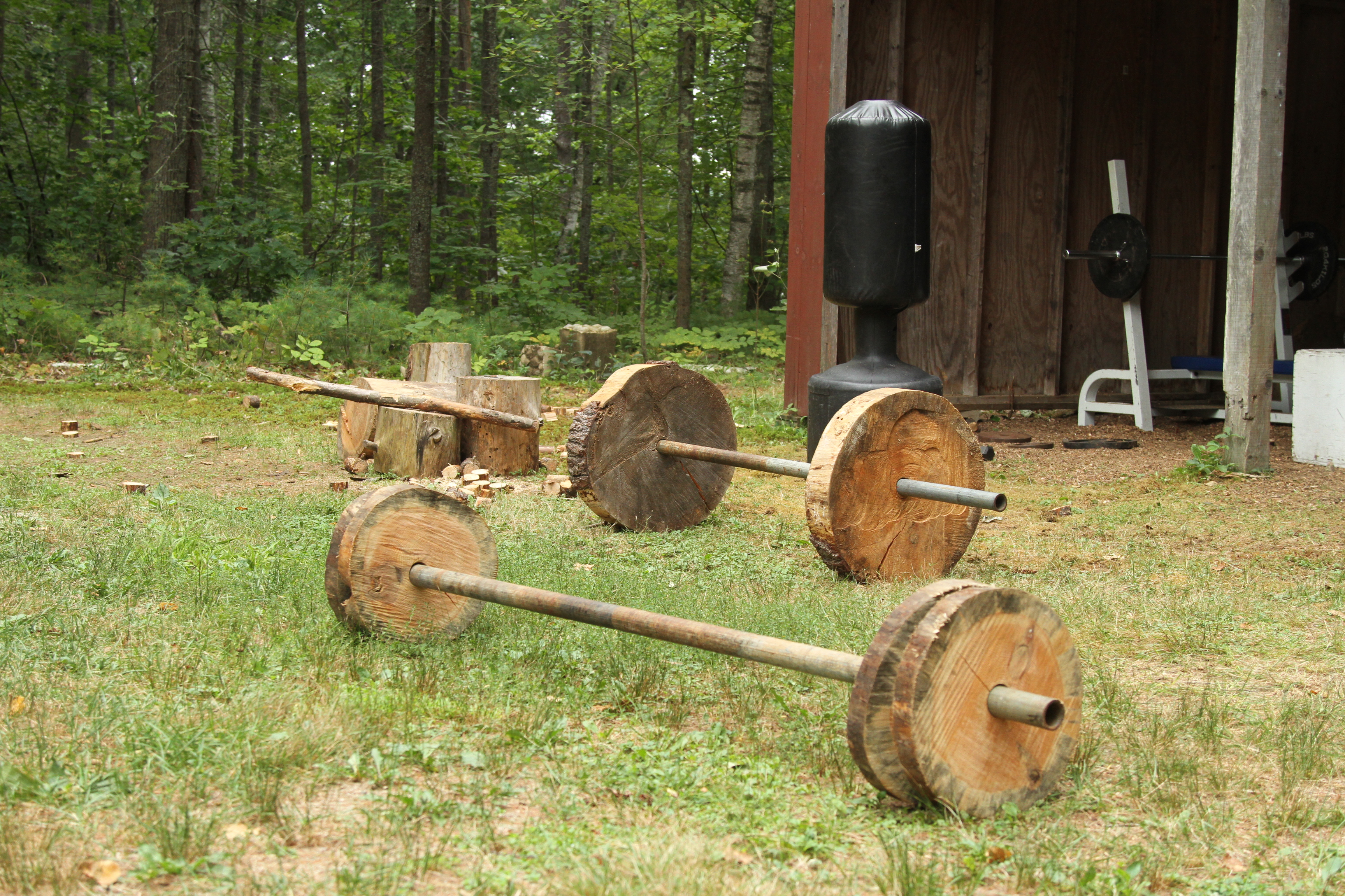 Log weights in front of Rocky Gym