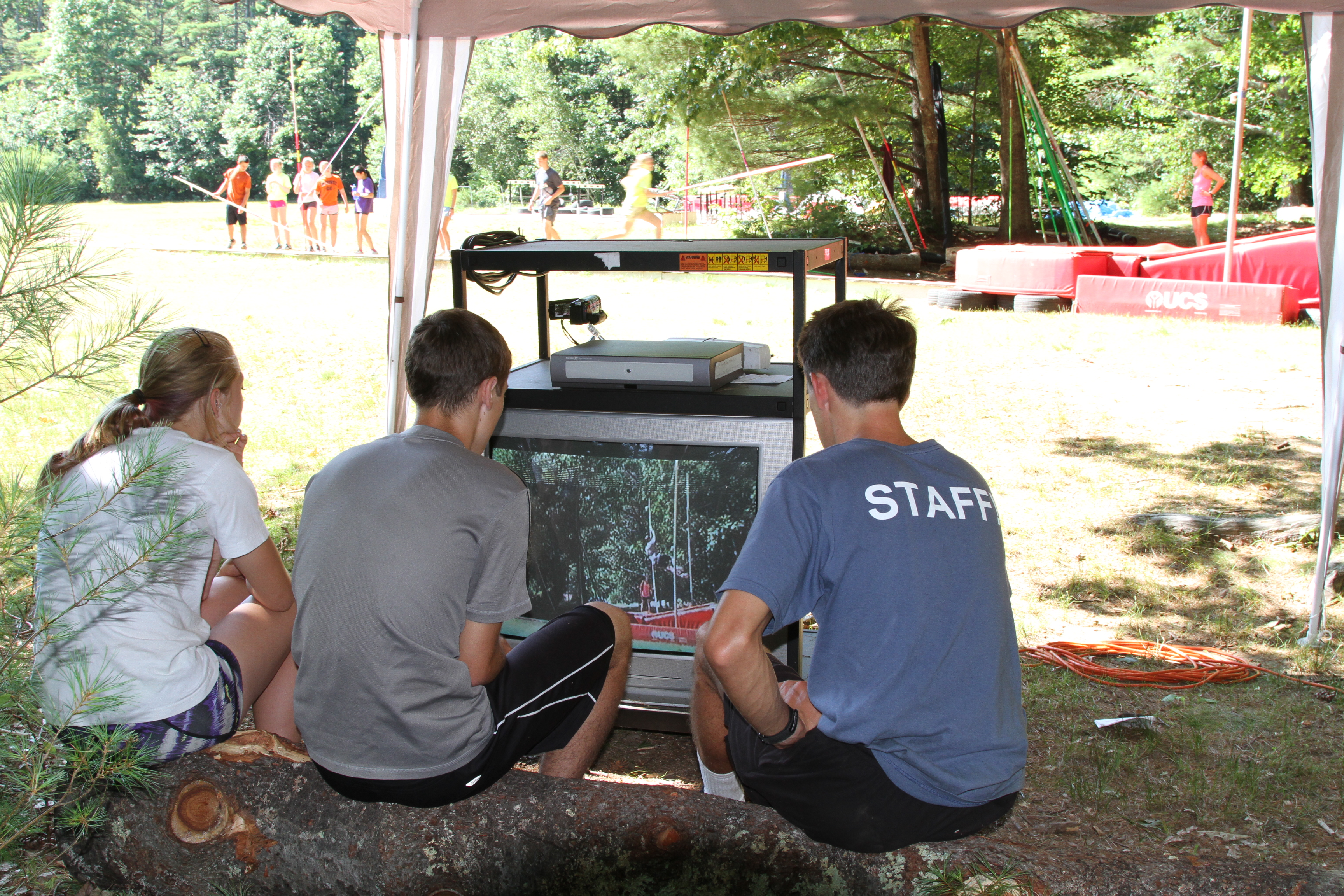 Campers reviewing their jumps on video with Rocky