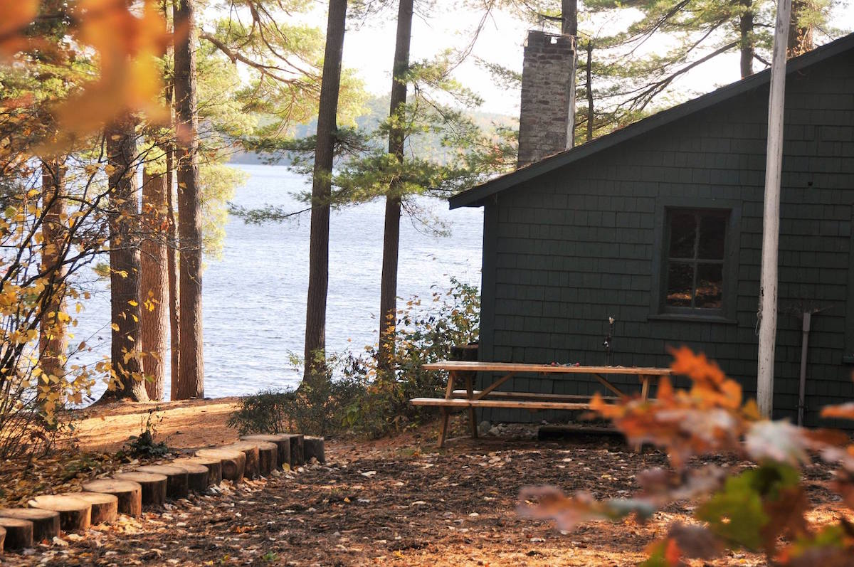The Maine Lodge with the lake in the background on a fall day