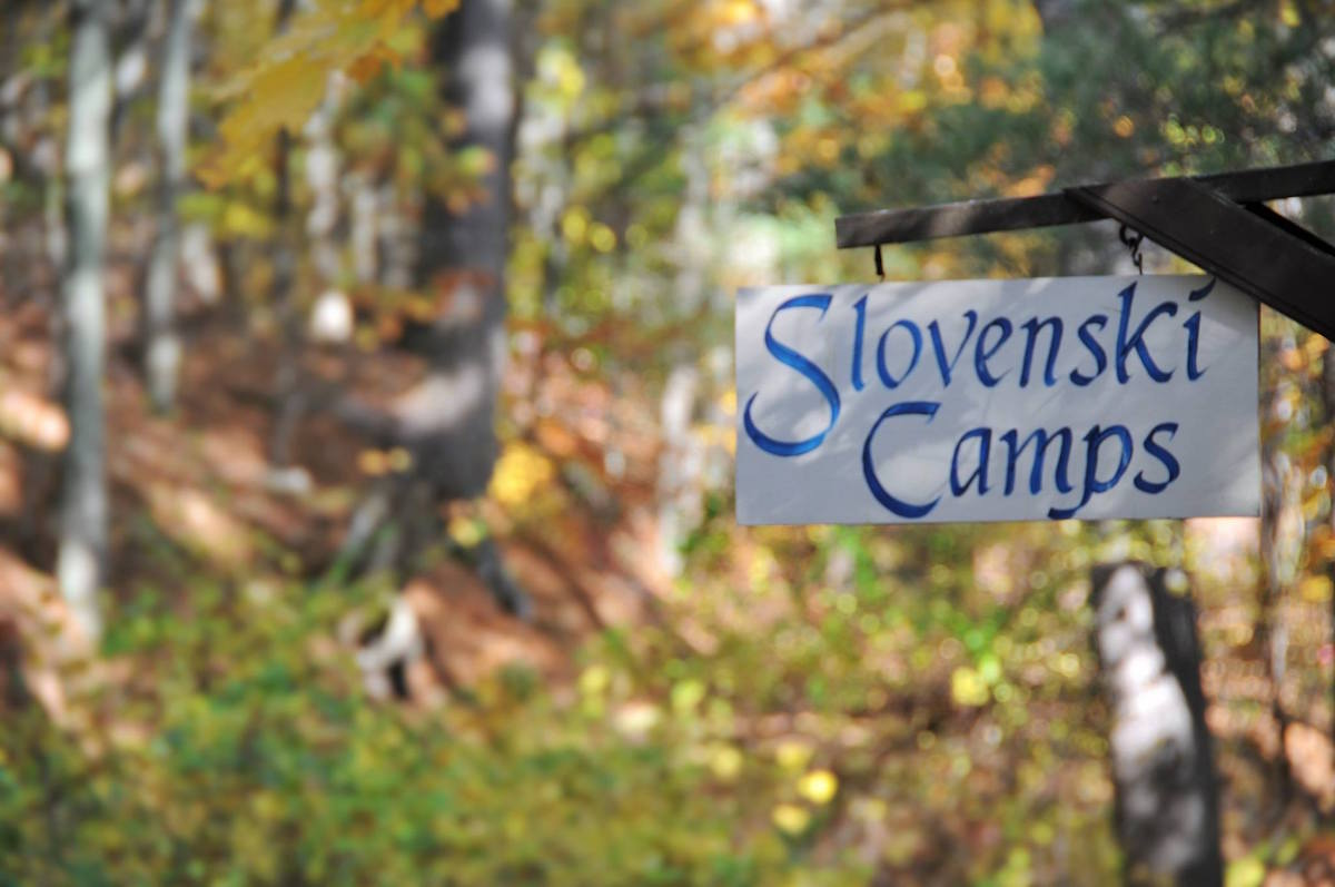 Slovenski camps road sign at the entrance