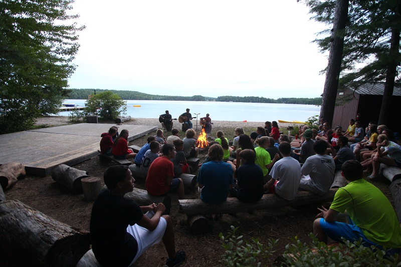 Campers gathered around the campfire