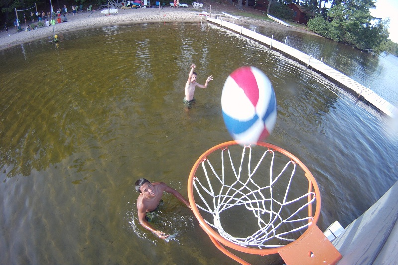 Campers shooting hoops in the water