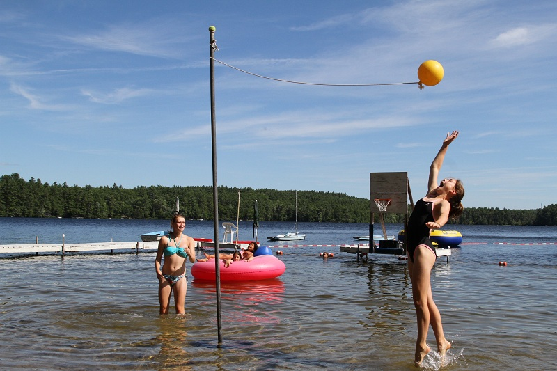 Campers playing water tetherball